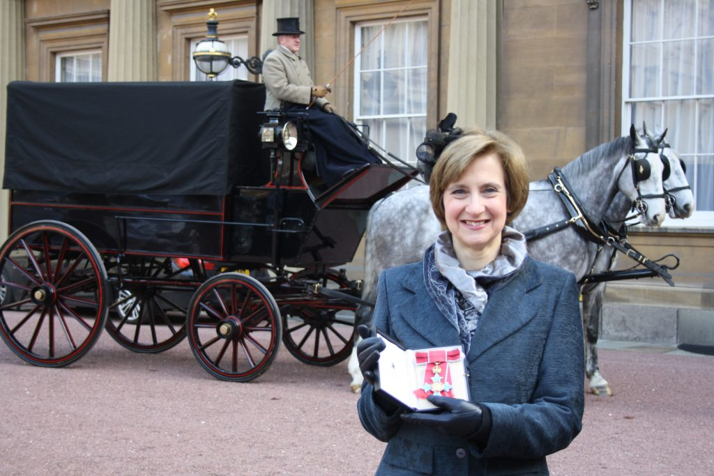 Maggy receiving her CBE at Buckingham Palace